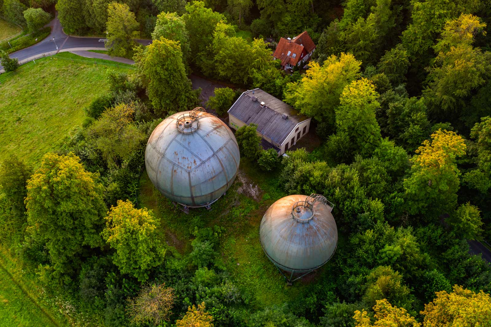 Sunrise above the old gasometers in the Teutoburg Forest (Bielefeld-Bethel, Germany).