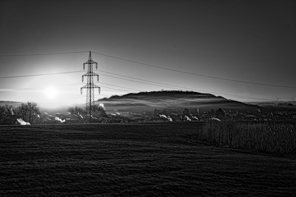 Photograph of a sunrise on top of a hill at 'Lippepark' in Hamm (Germany).