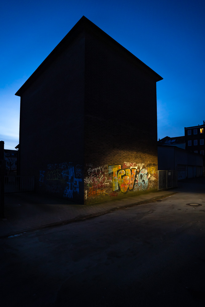 Graffiti in the light of a street lamp