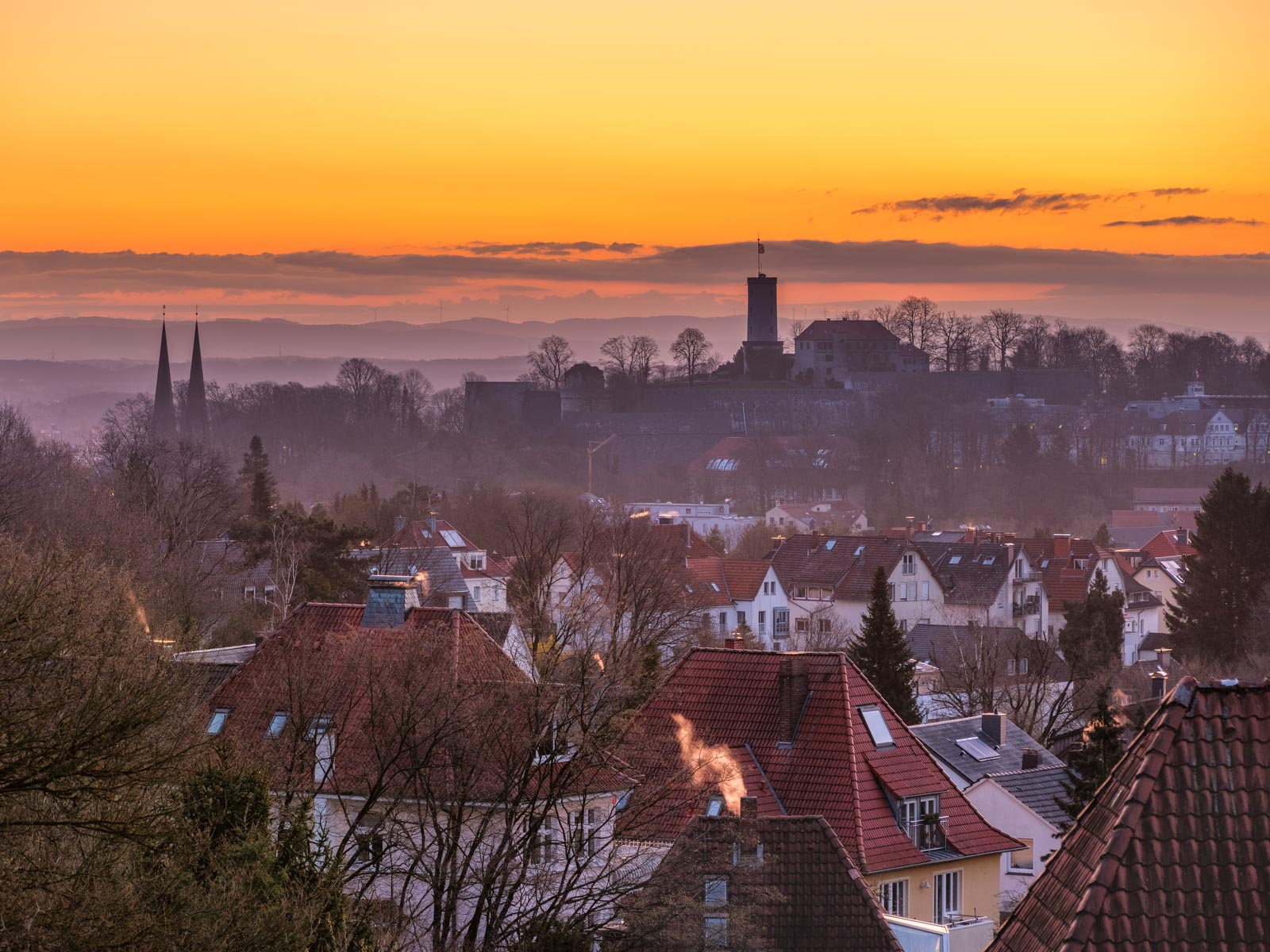 Spring sunrise over Bielefeld with Sparrenburg Castle.