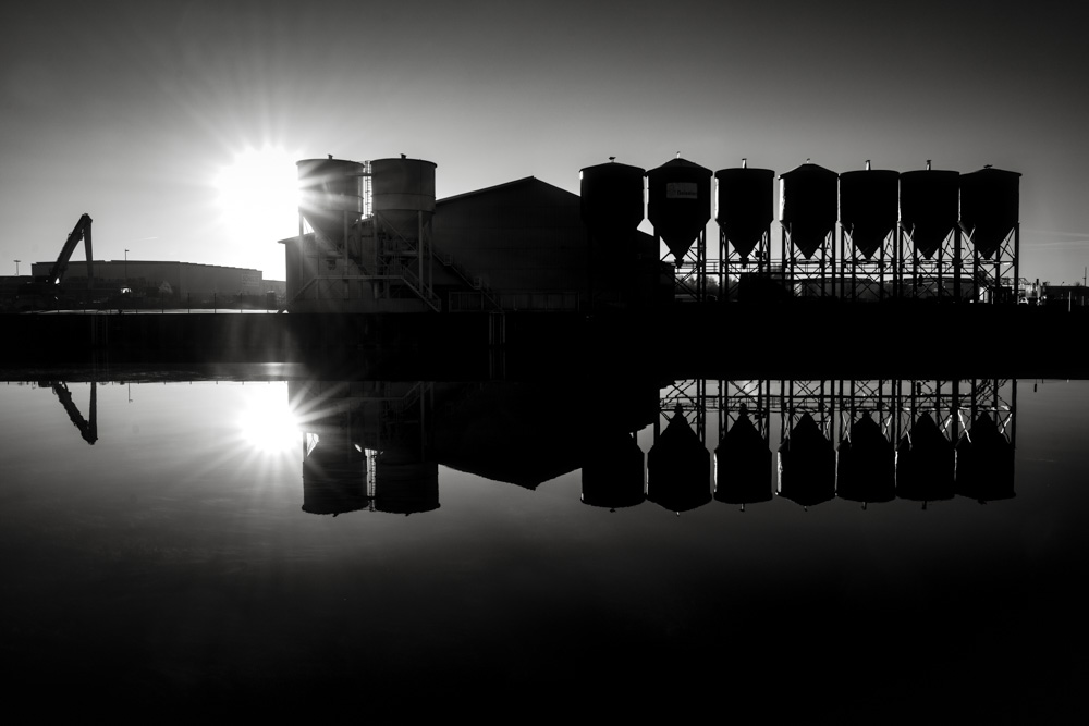Silhouette of an warehouse an silo complex at the 'Datteln-Hamm-Kanal' in Hamm, Germany.